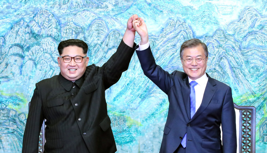 PANMUNJOM, SOUTH KOREA - APRIL 27:  North Korean leader Kim Jong Un (L) and South Korean President Moon Jae-in (R) pose for photographs after signing the Panmunjom Declaration for Peace, Prosperity and Unification of the Korean Peninsula during the Inter-Korean Summit at the Peace House on April 27, 2018 in Panmunjom, South Korea. Kim and Moon meet at the border today for the third-ever Inter-Korean summit talks after the 1945 division of the peninsula, and first since 2007 between then President Roh Moo-hyun of South Korea and Leader Kim Jong-il of North Korea.  (Photo by Korea Summit Press Pool/Getty Images)